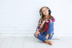 Child listening music Stock Image