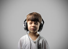 Child listening to music Stock Photos