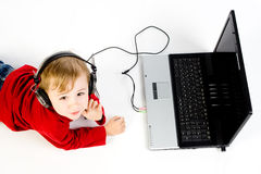 Child listening to music Royalty Free Stock Images
