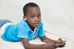 Child listening to music. The child listens to music from mobile phone of his father Royalty Free Stock Photography