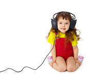 Child listens attentively to music on white Stock Photos