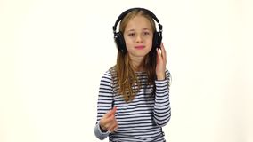 Child listens music and snaps fingers into rhythm, slow motion stock footage