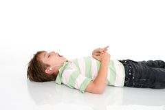 Child listing to music Stock Images