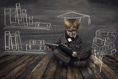 Child Little Boy in Glasses Reading Book over School Black Board. With Chalk Drawing, Kids Preschool Development, Children Education Concept Stock Image