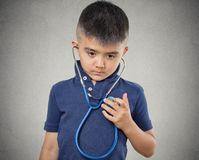 Child little boy listening to his heart with stethoscope royalty free stock image