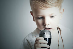 Child.little boy singing in karaoke.microphone.singer Royalty Free Stock Images