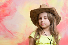Child, little girl in cowboy hat on colorful background Stock Photo