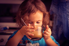 A child, a little girl. The child, a little girl drinking from a tea cup Stock Images