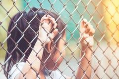 Child little girl hand holding steel mesh Stock Photo