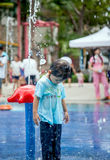 Child little girl having fun to play with water in park fountain Royalty Free Stock Images