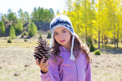 Child little girl holding pine cone in winter fall Stock Photography