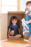 Child little girl inside box Royalty Free Stock Images
