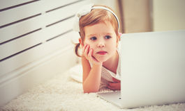 Child little girl with a laptop computer Royalty Free Stock Photo