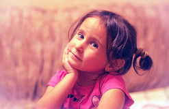 A child, a little girl. The child, a little girl on a pink background Royalty Free Stock Image