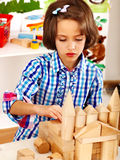 Child little girl playing bricks. Stock Photos