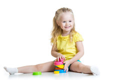 Child little girl playing with color toys Royalty Free Stock Image