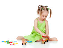 Child little girl playing with developmental toy Stock Images