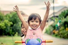 Child little girl raises her hand stock photos