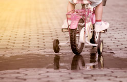 Child little girl riding bike in park Royalty Free Stock Photography