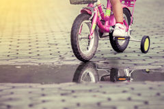 Child little girl riding bike in park Royalty Free Stock Images