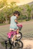 Child little girl riding bike in park Royalty Free Stock Image