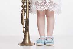 Child.little girl with trumpet Royalty Free Stock Photos