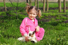 Child and little goat pet Royalty Free Stock Photography