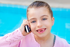 Child little indented girl talking mobile phone Royalty Free Stock Photo