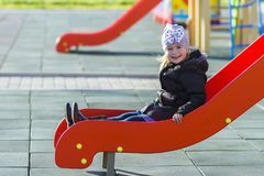 Child little pretty girl playing on playground outdoors Royalty Free Stock Photography