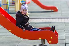 Child little pretty girl playing on playground outdoors Stock Photo