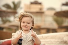 Child little smiliong boy pointing with pointer fingers royalty free stock photo