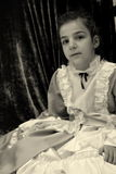 Child. Little woman dressed as a lady, historical period eight hundred stock photo