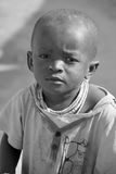 Child living in town of Bangani. BANGANI NAMIBIE OCTOBER 10: Unidentified child living in town of Bangani on october 10 2014. In Namibia About 27.6 per cent of Stock Photo