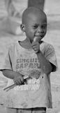 Child living in town of Bangani. BANGANI NAMIBIE OCTOBER 10: Unidentified child living in town of Bangani on october 10 2014. In Namibia About 27.6 per cent of Stock Image
