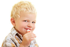 Child with lollipop Royalty Free Stock Images