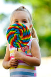 Child with lollipop Stock Images