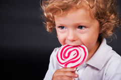 Child with lollipop Stock Image