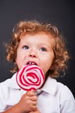 Child with lollipop Stock Photography