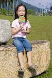 Child with Lollipop at Playground. Image of a child with a lollipop at a playground royalty free stock image