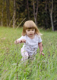 Child in long grass Stock Photo