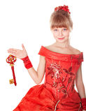 Child in long red dress holding christmas key,. Royalty Free Stock Photography