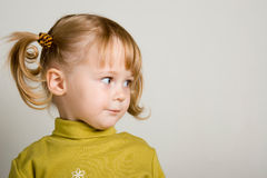 Child look. Young pretty girl in green looking forward Stock Images