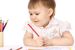 Child look at her drawings and smile Stock Photography