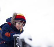 Child look at you on winter bridge Royalty Free Stock Photography