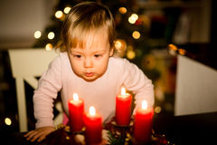 Child looking at advent wreath Stock Photos