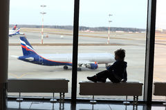 Child looking at aircraft Royalty Free Stock Photography