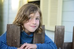 Child looking through bars of  fence Royalty Free Stock Photography