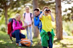 Child looking through binocular. Nature stock photography