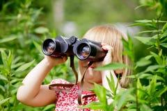 Child looking through binoculars Royalty Free Stock Image