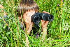 Child looking through binoculars Stock Photo